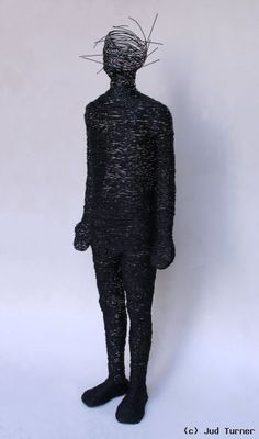 """Jud Turner - """"I AM"""" is welded steel rod figure, which refers to the moment when a human being realizes they have many more components than simply the physical body. It references spiritual epiphany."""