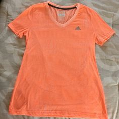 ADIDAS Ultimate Tee Awesome tee for working out or anytime! Neon orange with a very subtle pattern-tone on tone. Worn a couple times-decided it wasn't the right fit for me...hope it is for you! Adidas Tops Tees - Short Sleeve