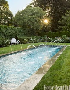 Pool Fountains - If you& putting in a pool, consider a saltwater chlorination system. It can be more expensive to install but cheaper to maintain. And the water feels great- no chemical smell, stinging eyes, or green hair. Garden Makeover, Backyard Makeover, Deck Makeover, No Grass Backyard, Fun Backyard, Backyard Kitchen, Garden Grass, Garden Paths, Pool Water Features