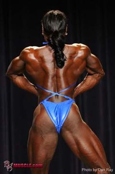 Female body builder shows sexy back muscles