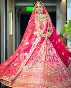 Love this pink red Sabyasachi bridal lehenga with two dupattas. Pink Bridal Lehenga, Sabyasachi Lehenga Bridal, Wedding Lehnga, Indian Bridal Lehenga, Indian Gowns, Lehenga Dupatta, Bollywood Lehenga, Red Lehenga, Sarees