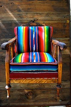 Going to buy blankets like this and make  cushions for my iron, 50's patio chairs. LOVE!!!