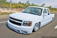 Dropped Chevy white truck