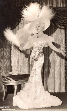 "MAE WEST in 'Belle of the Nineties' 1934 Paramount Pictures. Costumes by TRAVIS BANTON. Photo by Don English (or Ted Allan) from an original 7""x8"" vintage photo. Stamped on verso. Set in the Gay Nineties.  (S'il vous plaît suivre minkshmink sur pinterest) (S'il vous plaît suivre minkshmink sur pinterest) #maewest #gaynineties #gayicons #hourglassfigure #feathers"