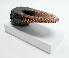 3D-printing pioneer Janne Kyttanen has used explosion welding to create a sculptural table that fuses metal and volcanic rock.