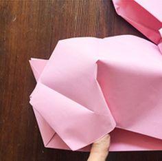 Enjoy a life-sized DIY Giant Origami Bunnies by DIY Ready at http://diyready.com/ diy-giant-origami-bunnies/