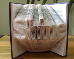 Folded book art, Shine, recycled book art by Dancing Grey Studio