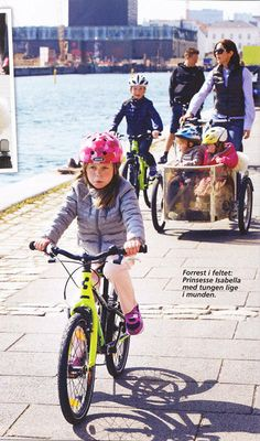 Princess Isabella leads the way with Prince Christian, her mum and the twins not far behind, going for a ride in Copenhagen