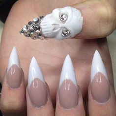 Image via   Black & clear negative space elegant stiletto nail art - in the colour that goes with everything & seen at many catwalk shows.....