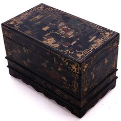 This black lacquer painted box started life as a presentation box for a gift - most likely some kind of expensive food. It comes from Pingyao, an ancient walled city in Shanxi province in central China. The paintings are old and are dinstictive of that particular area. The paintings are mainly in gold, complemented with creams, blues and greens against the black background. Boxes like these in an original state are now quite rare and still make beautiful ornaments or gift boxes today.