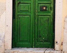 Deep green double doors.