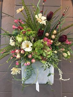 A rustic white wall pocket accented with spring flowers Christmas Floral Arrangements, Flower Arrangements, Over Couch Decor, Christmas Wreaths, Advent Wreaths, Christmas Tables, Door Wreaths, Grapevine Wreath, Cemetery Flowers