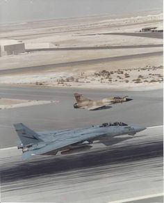 F-14B flying low with Mirage 2000