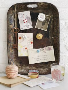 Two creative ideas. One is creating recycled jewelry magnets from unused or broken jewelry. And two is the idea to use an old, tarnished serving tray as a magnetic service to hang notes, postcards, etc. I love these!