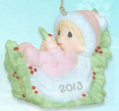 Precious Moments 2013 Dated Ornament Baby's First Christmas - Girl From the Annual Precious Moments Dated Christmas Collection. We invite you to Commemorate baby's first Christmas with this 2013 Dated Christmas Ornament. Perfect for the new baby girl in the family. This ornament is made of porcelain. $25.00 #PreciousMoments #Christmas