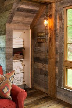 John Kraemer & Sons used an extensive amount of natural materials on both the interior and exterior of this Northern Wisconsin Bunk House, which included natural stone, and reclaimed wood sourced from Montana. Haus Am See, Barn Renovation, Lake Cottage, Rustic Bathrooms, Tiny House Design, Cabin Design, Luxury Interior Design, Rustic Barn, The Ranch