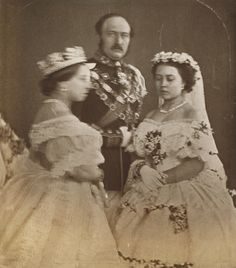 1858 Queen Victoria and Prince Albert with their eldest daughter Victoria (Vicky). On this day, Vicky was getting married; Queen Victoria was anxious for her, and thus she couldn't stop shaking (this is why she's blurry). Queen Victoria Prince Albert, Queen Victoria Family, Victoria Reign, Victoria And Albert, Albert Prince Consort, Queen Victoria Wedding, Victoria Post, Princesa Victoria, Reine Victoria