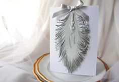 Silver feather table number design. Beautiful!