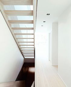 A skylight above the staircase in this home enables natural light to permeate through the open risers.