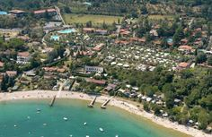 Villenpark Sanghen Manerba Del Garda Set on a beautiful bay on Lake Garda, Villenpark Sanghen has direct access to the public beach. Its grounds include 3 swimming pools, a tennis court and a children's playground. Boast storage is also available on site.