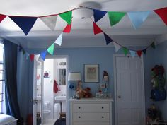 What fun! Bunting from the ceiling in a boys' shared room!