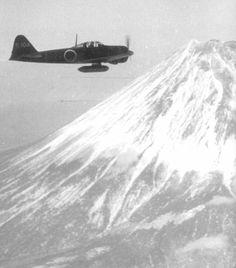 Mitsubishi A6M2 model 21 zero flying over Fuji-san.