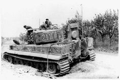 British Solders on a abandoned Tiger Tank in Italy