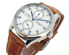 Parnis Power Reserve Chronometer.  A good looking automatic watch for the man without the budget to match his style.