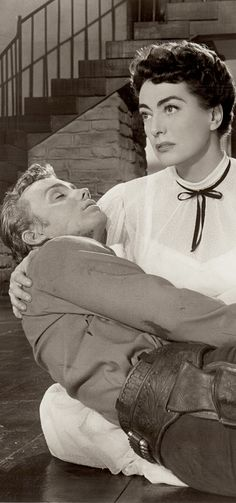 """DETAIL : JOAN CRAWFORD as Vienna, with Ben Cooper as Turkey Ralston (in her arms) in JOHNNY GUITAR 1954 REPUBLIC. Nicolas Ray's cult psychological Western masterpiece. There is some underlying eroticism in this photo. 10""""x8"""" vintage photo (minkshmink)"""