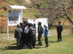 Students in southern Kyrgyzstan view a Village Hazard and Vulnerability  map that was part of a project implemented by Save the Children.