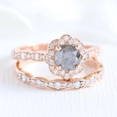 Beautifully crafted diamond bridal set of a vintage inspired grey diamond engagement ring with a round cut salt and pepper gray diamond set in rose gold vintage floral diamond ring setting pairs… Daha fazlası Grey Diamond Engagement Ring, Grey Diamond Ring, Vintage Inspired Engagement Rings, Floral Engagement Ring, Diamond Wedding Sets, Vintage Diamond Rings, Timeless Engagement Ring, Morganite Engagement, Halo Engagement