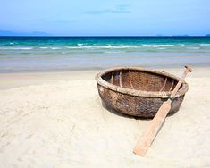 China Beach Vietnam. (Coracles are flimsy looking little wicker boats that look a bit like turtle shells).