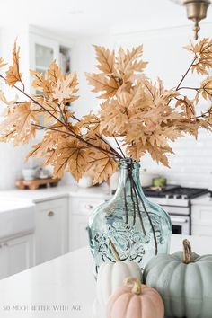 Light colored fall leaves in light green glass vase. I love muted colors and neutral decor and I usually decorate for fall that way too. I want my fall decor to work seamless with the rest of my house and not stand out too much. Fall Home Decor, Autumn Home, Fall Decor For Mantel, Modern Fall Decor, Fall Kitchen Decor, Thanksgiving Decorations, Seasonal Decor, Thanksgiving Games, Diy Halloween Decorations