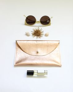 golden peach metallic leather pouch | ann-ya