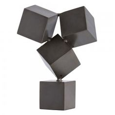 Cubist…Brutalist…Industrial? This dark natural iron tabletop sculpture qualifies as all three. These four cubes, balanced on-pointe, create a visual tension that will garner a second look in any room. Perfectly sized for a bookcase or tabletop.