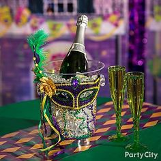 Give your Champagne a pop of Mardi Gras style! Dress up a clear ice bucket with green, purple and gold beads, then finish it with a feathered mask!