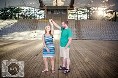 He is twirling her engagement picture at Worlds Fair Site by Amanda May Photos