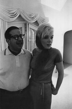 Marilyn with Henry Weinstein during a party at Weinstein's house, January 1962. Photo by Arnold Newman.