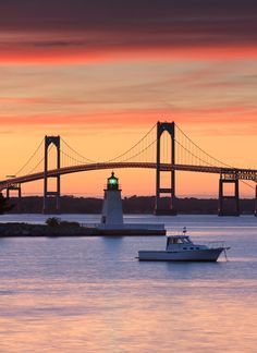 Sunset at the Goat Island Lighthouse with the Newport Bridge in the background.  Newport, RI, USA ~  (by Katherine Gendreau)