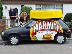 Some claim that if you put a blob of Marmite on a plate and repeatedly tap it with a spoon, it can turn white. Here are some other facts about Marmite Kitchen Decor Signs, Marmite, Brown And Grey, Facts, Canning, Car, Spoon, Extensions, Garage