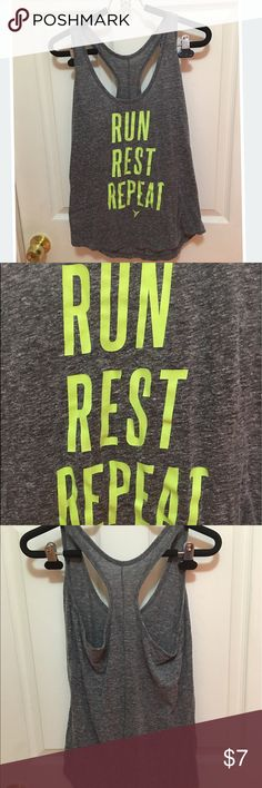"""Old Navy Run Rest Repeat Workout Tank Old Navy Active """"Run Rest Repeat"""" Workout Tank. Semi fitted. Medium but could also fit small. Grey with lime green. Cotton. Super comfortable and cute to wear to workout or for fun! 🏃 Old Navy Tops Tank Tops"""