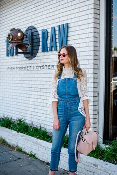 Alyssa Campanella of The A List blog's 48 Hours in Charleston dining at 167 Raw wearing Wayf Citha lace top and Senreve mini Maestra bag