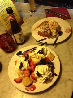 Dutch poffertjes with strawberries, cream, ice cream and chocolate swirls. Apple tart with cream and ice cream at the pancake bakery, Amsterdam