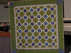 Blue Bayou by Jo Morton.   This pattern had a measurement error in the inner boarders - the points didn't line up.  She took it off the market, and reissued it as Brown Bayou with correct boarder.