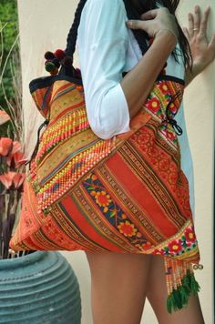 """This beautiful true Vintage bag is crafted in the North of Thailand using one whole baby carrier that was hand woven by the local HMONG hill tribes. The baby carrier is up-cycled to create this beautiful work-of-art bag.    Each bag is unique and each carries its own story.    Length: 19""""  Height: 17""""  Strap: 25""""  Zippered Inside Pocket"""
