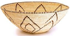 In Northern Namibia, near the town of Oshikuku, these baskets are woven by rural Ovambo people using traditional patterns and techniques.