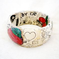 Valentine Recycled Bracelet. Could do with grandmas old plastic bracelet, newspaper, stickers, and white glue.