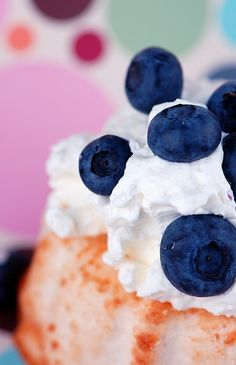 Angel Food Cake with White Chocolate Cocoa Whipped Cream Frosting ....scattered with blueberries