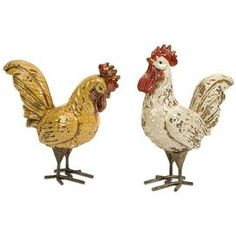"""Set of two ceramic rooster statuettes.         Product: Small and large rooster décor     Construction Material: Ceramic    Color: Mustard and ivory        Dimensions: Small: 9.75"""" H x 8.75"""" W Large: 11"""" H x 10.75"""" W"""