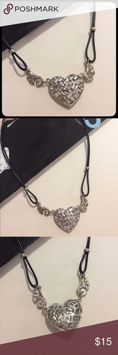 Heart Silvertone Cord Black Choker Heart Clear Stones Black Cord Choker. Brand New. Has extra extender. Heart has clear baguettes stone (it sparkles but hard to photograph). Feel free to ask questions. Reasonable offers are welcome. Bundle and Save. Thanks😊 Jewelry Necklaces